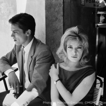 Alain Delon and Monica Vitti during a break on the set of _Eclipse_. Rome, 1961